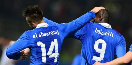 Italy's Stephan El Shaarawy (L) celebrates after scoring with Mario Balotelli