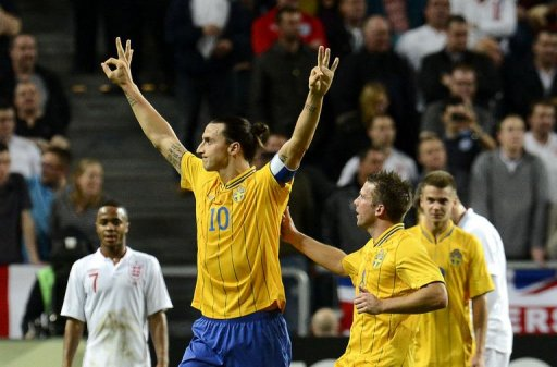 Sweden's Zlatan Ibrahimovic (C) celebrates with his teammates after scoring his 3rd goal