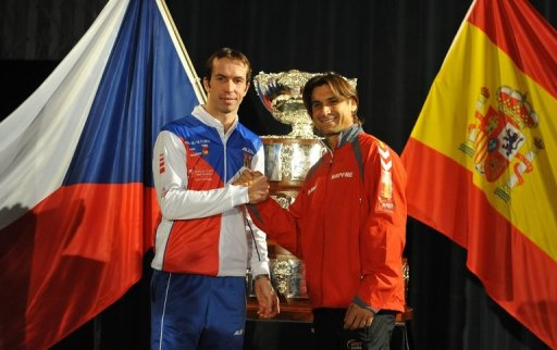 Radek Stepanek (left) shakes hand with David Ferrer after the Davis Cup final draw ceremony in Prague