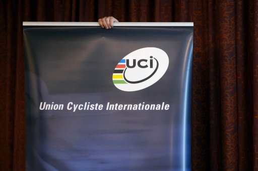 A woman installs a UCI logo prior to a press conference on the decision about the fate of Lance Armstrong on October 11