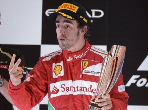 Ferrari's Spanish driver Fernando Alonso  celebrates on November 4 after the Abu Dhabi Formula One Grand Prix