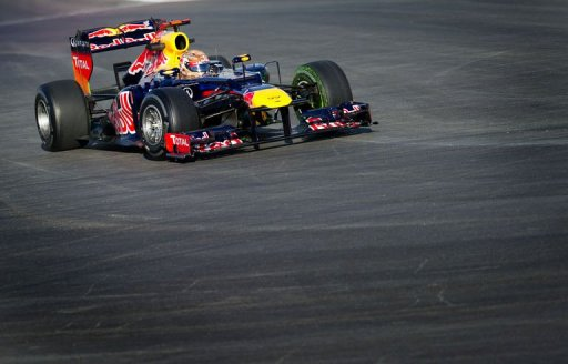 Sebastian Vettel of Red Bull Racing enters turn 1 during the first practice session