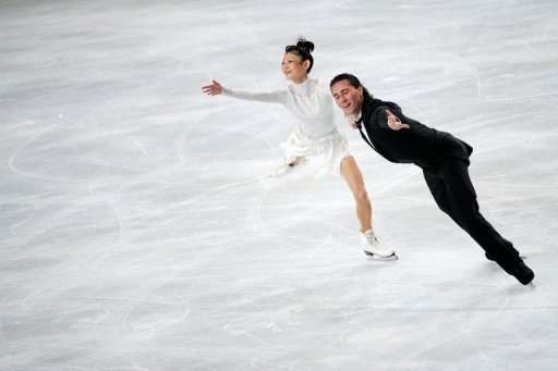 Yuko Kavaguti and Alexander Smirnov of Russia perform in their pairs short program
