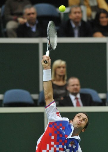 Radek Stepanek of Czech Republic serves a ball