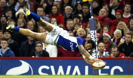 Samoa's centre George Pisi dives to score a try