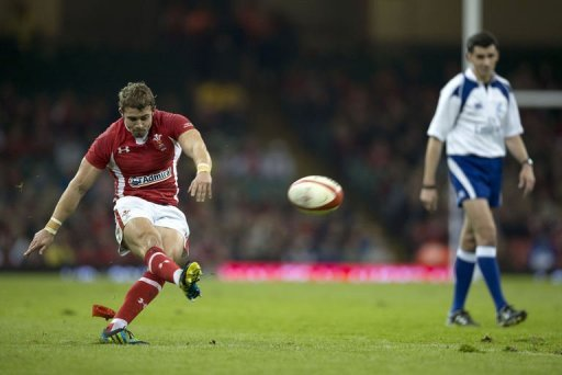 Wales' full back Leigh Halfpenny (L) kicks a conversion