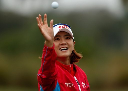Na Yeon Choi of South Korea reaches for a golf ball