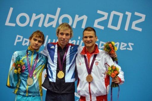 Ukraine's silver medallist Yevheniy Bohodayko (left) poses on the podium