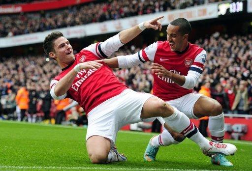 Arsenal's Olivier Giroud (L) celebrates scoring their third goal with Theo Walcott