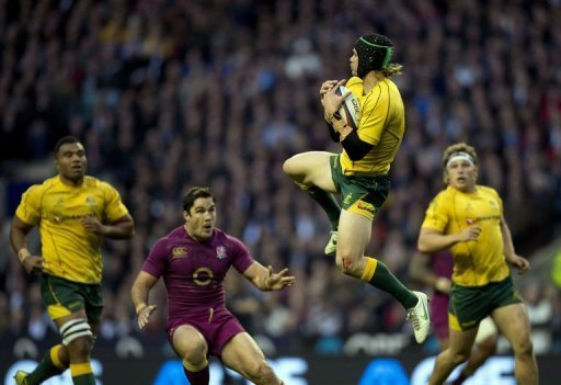 Australia's full back Berrick Barnes (2nd R) jumps to catch the ball