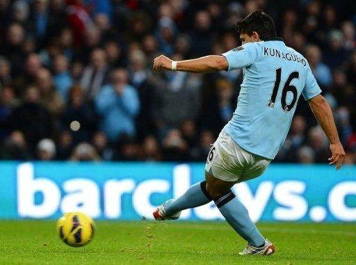 Manchester City's forward Sergio Aguero scores his team's second goal