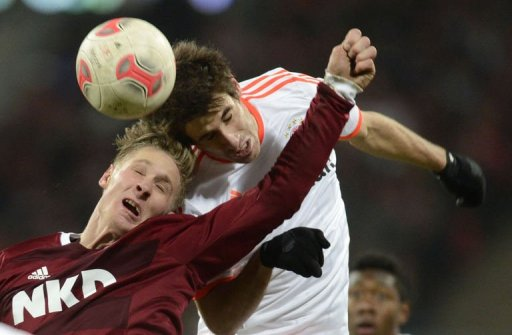 Bayern Munich's midfielder Javi Martinez (R) and Nuremberg's striker Sebastian Polter challenge for the ball