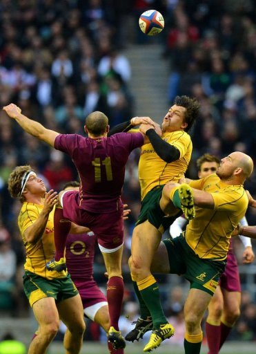 England wing Charlie Sharples (2nd L) jumps for the ball against Australia centre Adam Ashley-Cooper (2nd R)