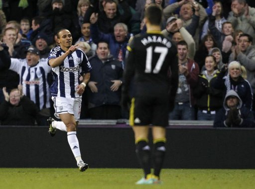 West Bromwich Albion's Peter Odemwingie (L) celebrates scoring