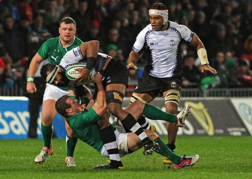 Ireland's hooker Sean Cronin tackles Fiji's lock Apisai Naikatini (up)