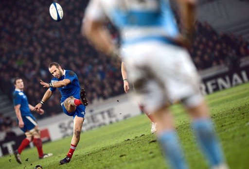 France's fly half Frederic Michalak (L) hits a penalty kick