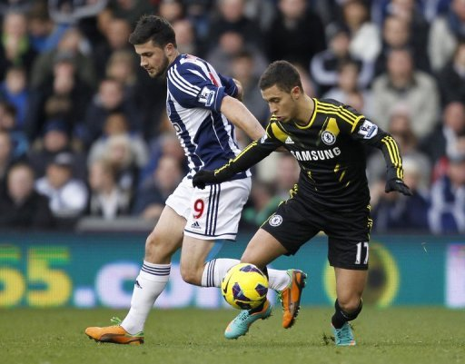 Shane Long (L) fired West Brom into an early lead before Eden Hazard (R) levelled just before half-time