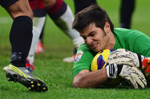 Cagliari's goalkeeper Michael Agazzi saves the ball