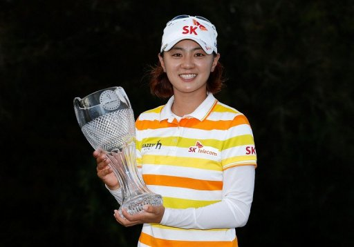 Na Yeon Choi of South Korea poses with the winner's trophy