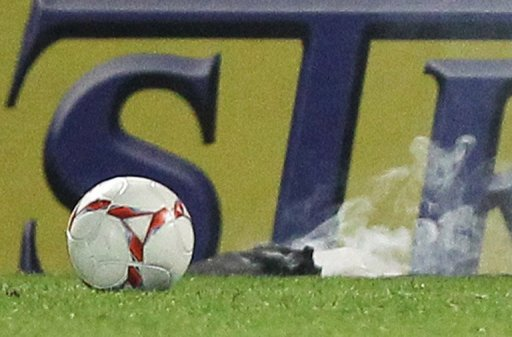 A Russian Premier League game was abandoned after a firecracker struck a goalkeeper