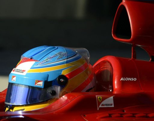 Spain's Fernando Alonso of Ferrari steers his car during the third practice session