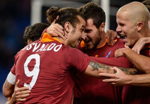AS Roma's Pablo Osvaldo (L) celebrates with his team mates after scoring