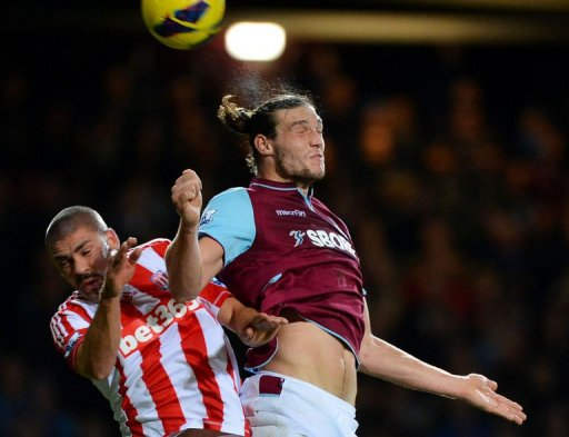West Ham's Andy Carroll (R) jumps for the ball against Stoke's Jon Walters