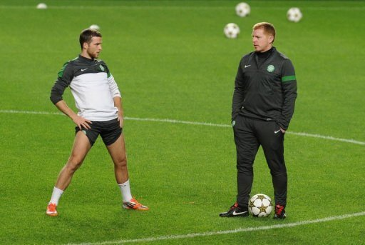 Celtic defender Adam Matthews (L) and coach Neil Lennon take part in a training session at Luz Stadium