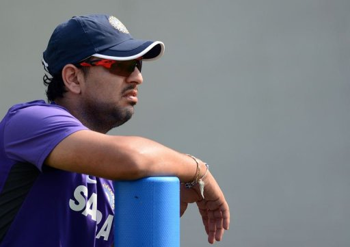 Indian cricketer Yuvraj Singh watches teammates during a training session on November 14