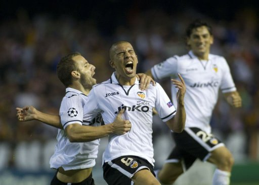 Valencia's Sofiane Feghouli (C) celebrates after scoring