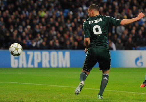 Real Madrid's Karim Benzema scores the opening goal
