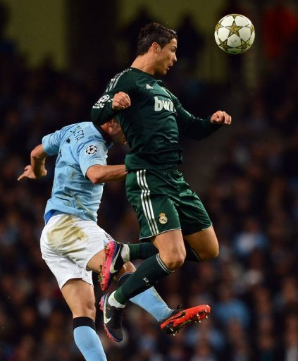 Manchester City's Pablo Zabaleta (L) jumps with Real Madrid's Cristiano Ronaldo