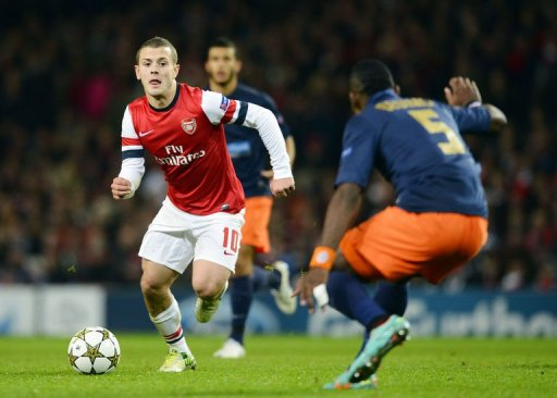 Arsenal's Jack Wilshere (L) vies with Montpellier's Henri Bedimo