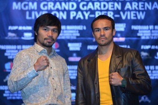 Boxers Manny Pacquiao (L) and Juan Manuel Marquez (R)