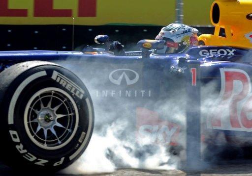 German Formula One driver Sebastian Vettel blocks the wheels of his RedBull during free practice at Interlagos