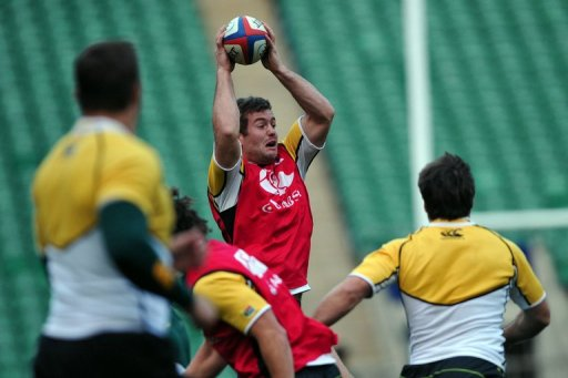 South Africa's centre Jaco Taute jumps for the ball during a training session at Twickenham in London