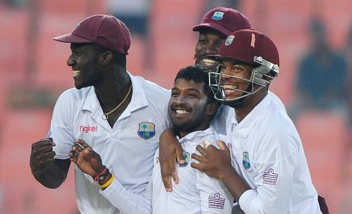 West Indies players celebrate the dismissal of Bangladeshi batsman Shakib Al Hasan (unseen)
