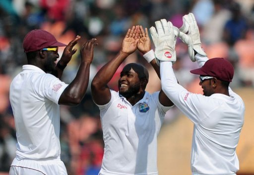West Indies bowler Tino Best (centre) celebrates the dismissal of Bangladesh's Shahriar Nafees (unseen)