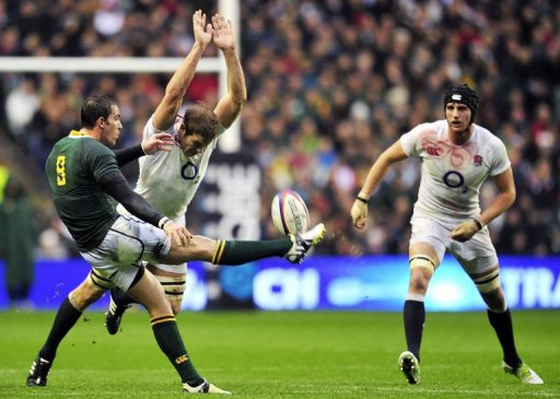 South Africa's scrum half Ruan Pienaar clears the ball during a Test match against England at Twickenham
