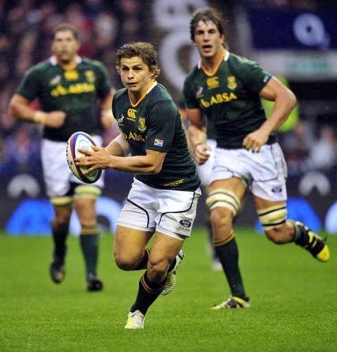 South Africa's fly-half Pat Lambie runs with the ball during the rugby union Test match against England at Twickenham