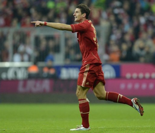 Bayern Munich's striker Mario Gomez celebrates the fifth goal against Hanover 96