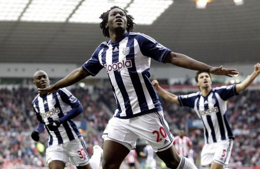 West Bromwich Albion's Belgian striker Romelu Lukaku (C) celebrates scoring their third goal against Sunderland