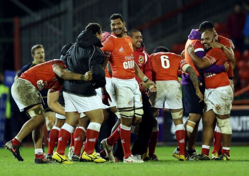 Tongan players celebrate victory during the International rugby union test match between Scotland and Tonga