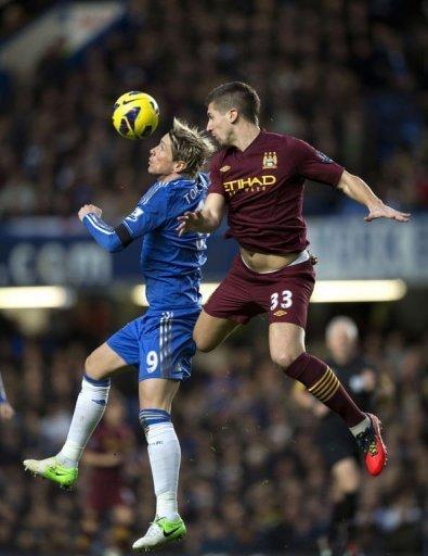 Chelsea's Fernando Torres (L) vies for the ball against Manchester City's Matija Nastasic