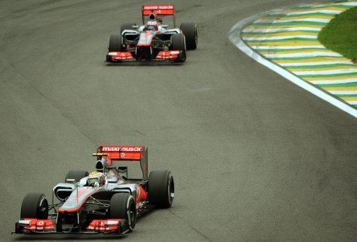 Lewis Hamilton powers his McLaren followed by teammate Jenson Button
