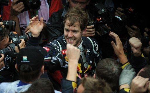 Sebastian Vettel celebrates with the Red Bull team