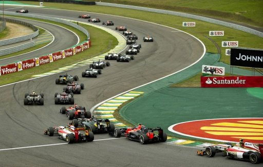 Lewis Hamilton (top L) leads the Brazil F1 GP first lap