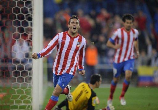 Atletico Madrid's Koke celebrates after scoring