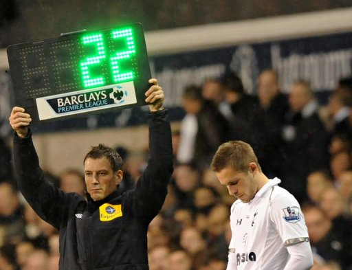 Referee Mark Clattenburg (L) attends the English Premier League football match between Tottenham Hotspurs and West Ham