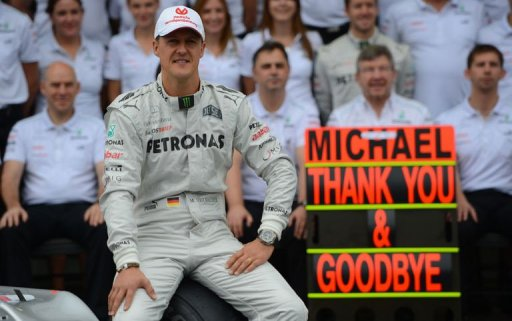Michael Schumacher poses with the Mercedes team